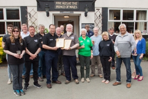 Ian Payne receiving the certificates, with staff, regulars and CAMRA volunteers